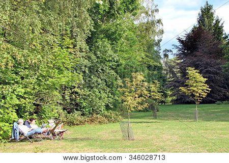 Lodz / Poland. 18 July 2019:  Two Women Pensioners Rest In City Park. Elderly Women Enjoy Vacation I