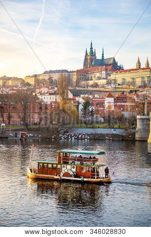 Prague, Czech Republic - 16.12.2019: Prague Castle Over River Vltava At Sunset Light In Desember Day