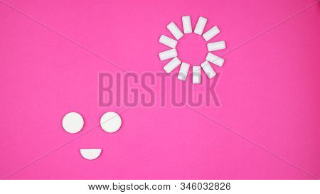 Chewing Gum On A Light Pink Background. Set Out In The Form Of The Sun And Smiles