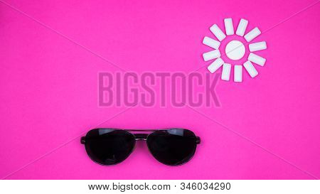 Chewing Gum On A Light Pink Background. Set Out In The Form Of The Sun. Bottom Of Sunglasses