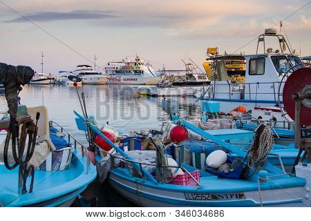 Agia Napa, Cyprus - October 22, 2019: Various Vessels In City Harbor At Sunset. Fish And Pleasure Cr