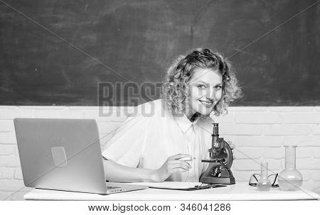Scientific Research. Microbiology Concept. Student Girl With Laptop And Microscope. Molecular Biolog