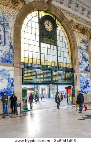 Porto, Portugal - Jan 10, 2020: Interior Of Sao Bento Railway Station With Typical Azulejo Tiles. Ty
