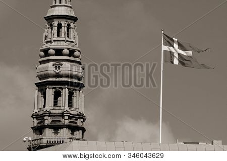 Old Photo Of Danish Flag In The Wind Next To The Church Tower In Copenhagen