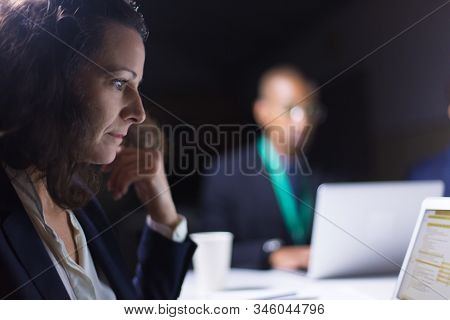 Thoughtful Mature Businesswoman Looking At Laptop Screen. Side View Of Focused Lady Working With Lap