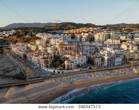 Aerial View Of Sant Pol De Mar Village And Its Church Ermita De Sant Jaume. Located In El Maresme Co