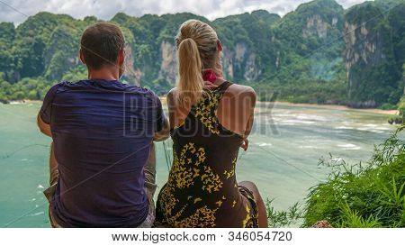 Couple On View Point To Hat Tom Sai Beach At Railay, Krabi, Thailand.