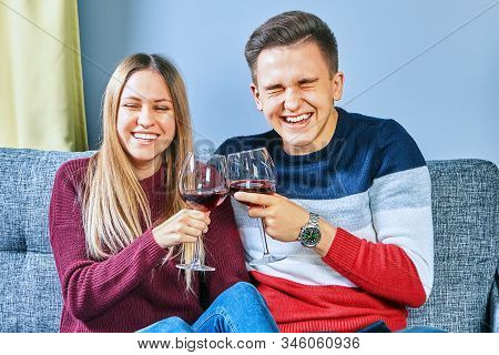 Happy Couple Drinking Together. Drunk On The University Campus, A Young Man And Woman Drink Alcohol