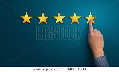Hand Of Client Giving A Five Star Rating On Blue Background, Panorama, Copy Space. Service Rating, S