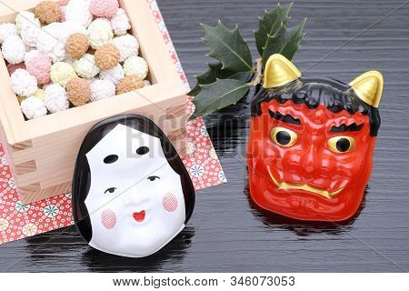 Japanese Traditional Setsubun Event, Soybeans And Masks Of Oni Demon And Otafuku Are Used On An Annu