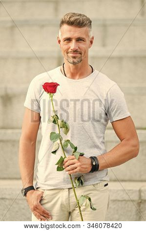 Handsome Guy With Rose Flower Romantic Date. Valentines Day And Anniversary. Flowers Delivery. Datin