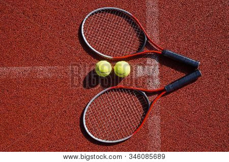 Top View Tennis Scene With Ball, Racquet And Hard Court Surface Corner Line
