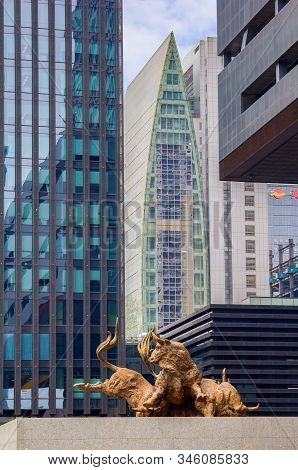 Shenzhen, China - November 14, 2015: The Bronze Bull Statue In Front Of The Shenzhen Stock Exchange