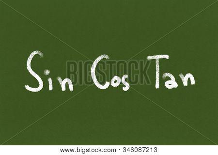 Handwritten Sin Cos Tan On Green Chalkboard Or Blackboard Texture. Illustration Trigonometric Formul
