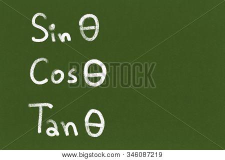 Handwritten Sin Zeta Cos Zeta Tan Zeta On Green Chalkboard Or Blackboard Texture. Illustration Trigo