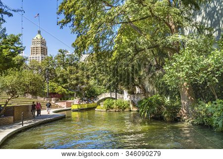 San Antonio, Texas, United States -  October 8, 2019 Old Tall Tower Life Building Bridge Tour Boat R