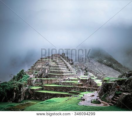 Amazing view of breathtaking Machu Picchu temple covered with fog