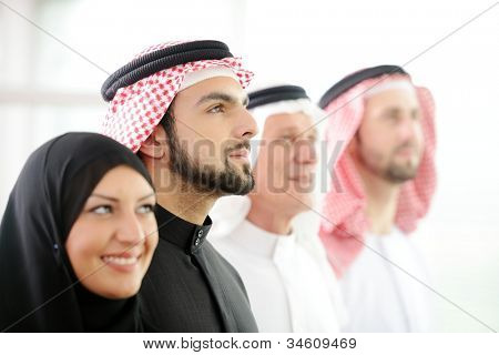 Successful and happy business arabic  people looking up