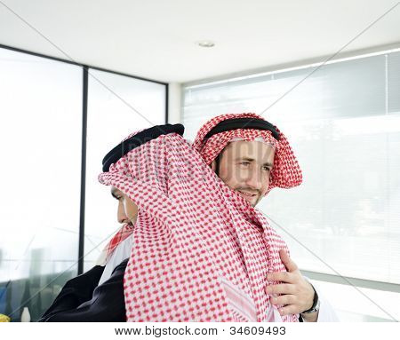 Arabic business people embracing each other at meeting for successful deal