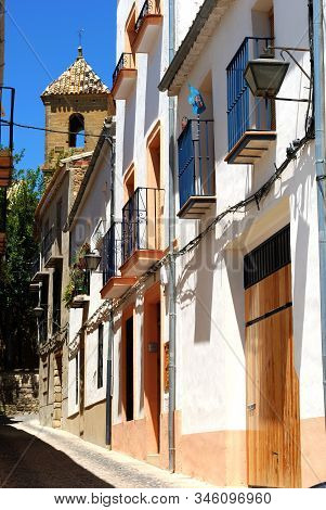 Town Houses In A Narrow Street With A Church Bell Tower To Rear, Ubeda, Andalucia, Spain.