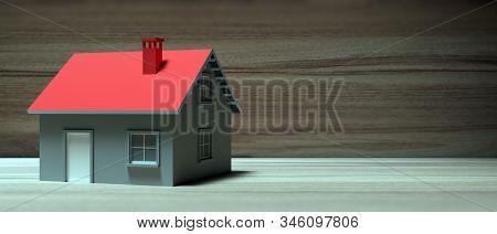 House Miniature Against Wooden Background. 3D Illustration
