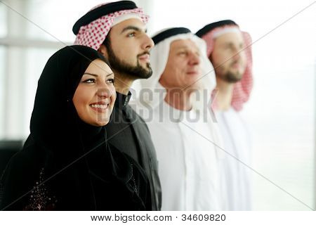 Successful and happy business arabic  people looking up,copyspace