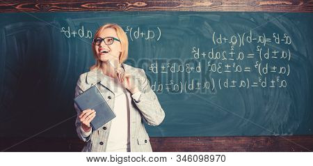 Teacher Smart Woman With Book Explain Topic Near Chalkboard. What Makes Great Teacher. School Teache