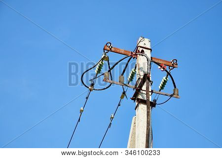 Electric Power Lines And Wires With Blue Sky. Support Of Power Lines In A Nice Day