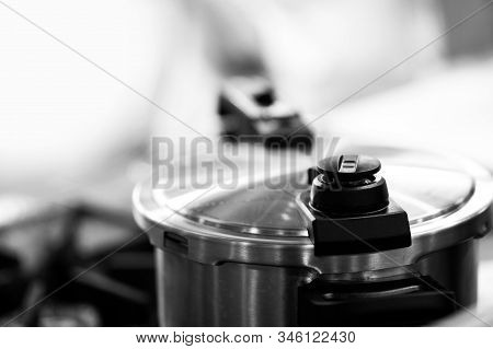 Pressure Cooker Steam Over Cooking In A Kitchen