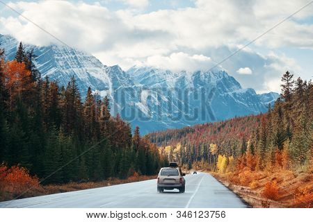 Car on road in Banff National Park in Canada