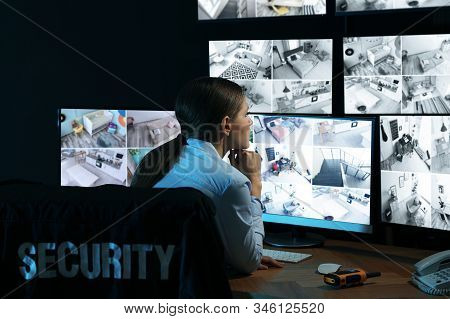 Security Guard Monitoring Modern Cctv Cameras Indoors At Night