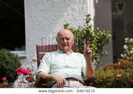 Senior Man Giving V-sign