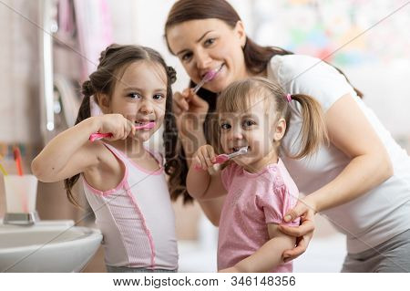 Happy Family Mum And Kids Brushing Their Teeth