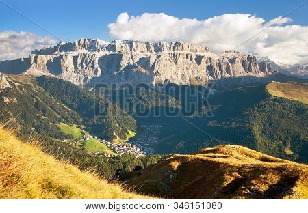 Evening View Of Sella Gruppe Or Gruppo Di Sella With Clouds And Selva Val Gardena Or Wolkenstein, So