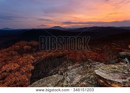 Sunset Over Charrred Landscape After Bush Fires Swept Through Parts Of Blue Mountains Australia In S