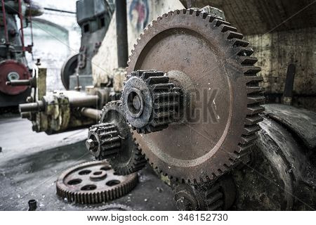 Rusting Cogs And Machinery At Abandoned Factory