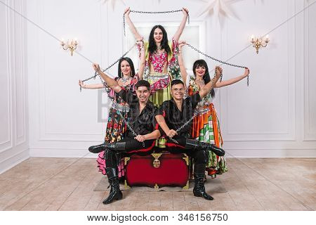 Ensemble Of Folk Gypsy Dance Sitting On The Big Throne