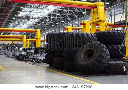 Warehouse With Tires For Trucks At An Industrial Plant For The Production Of Cars. Automotive Servic