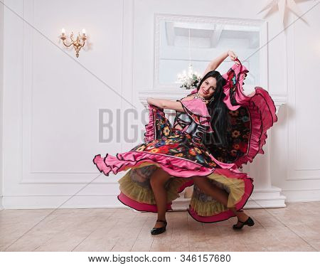 Beautiful Woman Dancer Performs Gypsy Dance. Photo With A Copy Of The Space