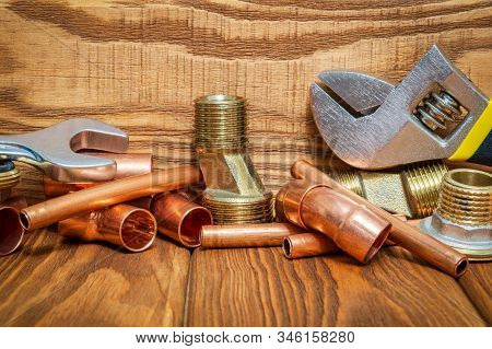 Spare Parts With Copper And Brass Accessories For Plumbing Repair On Vintage Wooden Boards