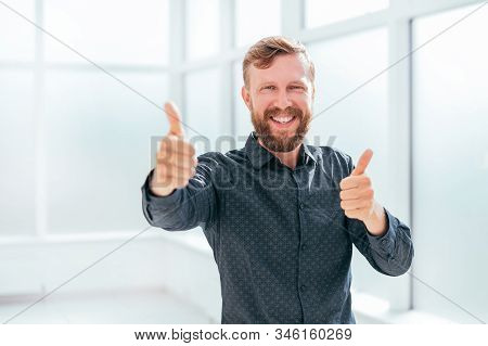 Happy Businessman Showing Thumbs Up. Photo With Copy Space