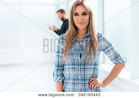 Young Business Woman Standing In New Office