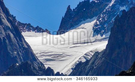 Scenic View Of The High Snow-capped Mountain Peaks And Snow-capped Glaciers Of The French Alps In Th