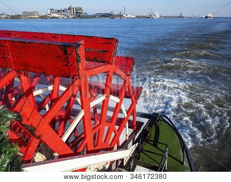 New Orleans, Usa - Dec 11, 2017: The Red Wooden Paddle-wheel Of The Historic Steamboat Natchez. On T