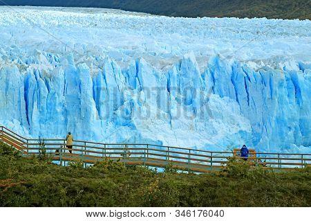 Boardwalk In Front Of A Massive Perito Moreno Glacier In The Los Glaciares National Park, Patagonia,