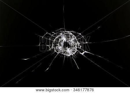 The Texture Of Broken Cracked Glass After Being Hit By A Solid Object. Cracks Isolated On White. Con