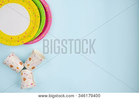 Red, Yellow, Green, And Pink Paper Plates, Boiler Tubes, And Paper Cups. Decoration With Paper Ribbo