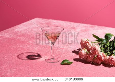 Rose Wine In Glass Near Bouquet Of Roses On Velour Pink Cloth Isolated On Pink, Girlish Concept