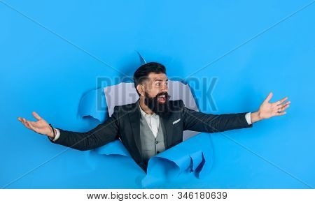 Business Growth. Businessman Celebrating Success Looking Through Hole In Paper Wall. Bearded Man Loo