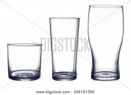 Several Glasses For Drinks Of Different Shapes And Sizes Isolated On A White Background